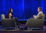 This image released by ABC shows host Alec Baldwin, right, speaking with TV personality Kim Kardashian West during an appearance on