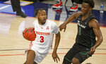 Houston guard DeJon Jarreau (3) drives past Tulane guard Sion James (1) during the second half of an NCAA college basketball game in the quarterfinals of the American Athletic Conference men's tournament Friday, March 12, 2021, in Fort Worth, Texas. (AP Photo/Ron Jenkins)
