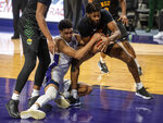 James Madison guard TJ Taylor (2) and Norfolk State guard Andre Bottoms (22) battle for the ball during the first half of an NCAA basketball game in Harrisonburg, Va., Friday, Nov. 27, 2020. (Daniel Lin/Daily News-Record via AP)