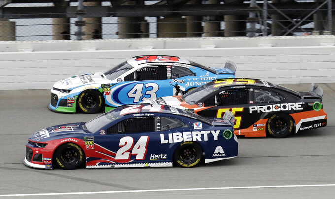 William Byron (24), Bubba Wallace (43) and Matt DiBenedetto (95) drive during the NASCAR Cup Series auto race at Chicagoland Speedway in Joliet, Ill., Sunday, June 30, 2019. (AP Photo/Nam Y. Huh)