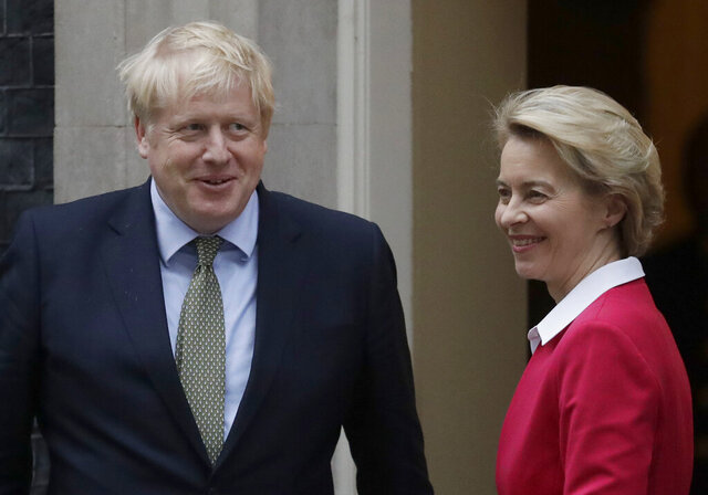 """FILE - In this Wednesday, Jan. 8, 2020 file photo, Britain's Prime Minister Boris Johnson greets European Commission President Ursula von der Leyen outside 10 Downing Street in London.  Johnson and European Commission President Ursula von der Leyen have agreed to stay in contact over coming days as their negotiating teams step up efforts to conclude a post-Brexit trade deal between the U.K. and the European Union. With less than two months to go before the U.K. exits the EU's economic orbit, a spokesman at Johnson's Downing Street office said the negotiating teams would """"redouble efforts to reach a deal"""" when the talks resume in London on Monday, Nov. 9, 2020.  (AP Photo/Matt Dunham, File)"""