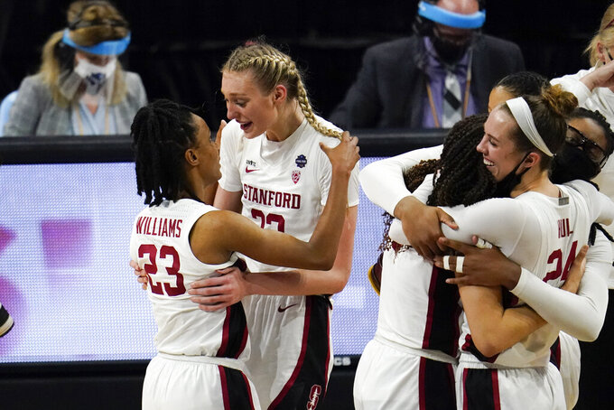 Stanford guard Kiana Williams (23) celebrates with teammate forward Cameron Brink at the end of the championship game against Arizona in the women's Final Four NCAA college basketball tournament, Sunday, April 4, 2021, at the Alamodome in San Antonio. Stanford won 54-53. (AP Photo/Eric Gay)