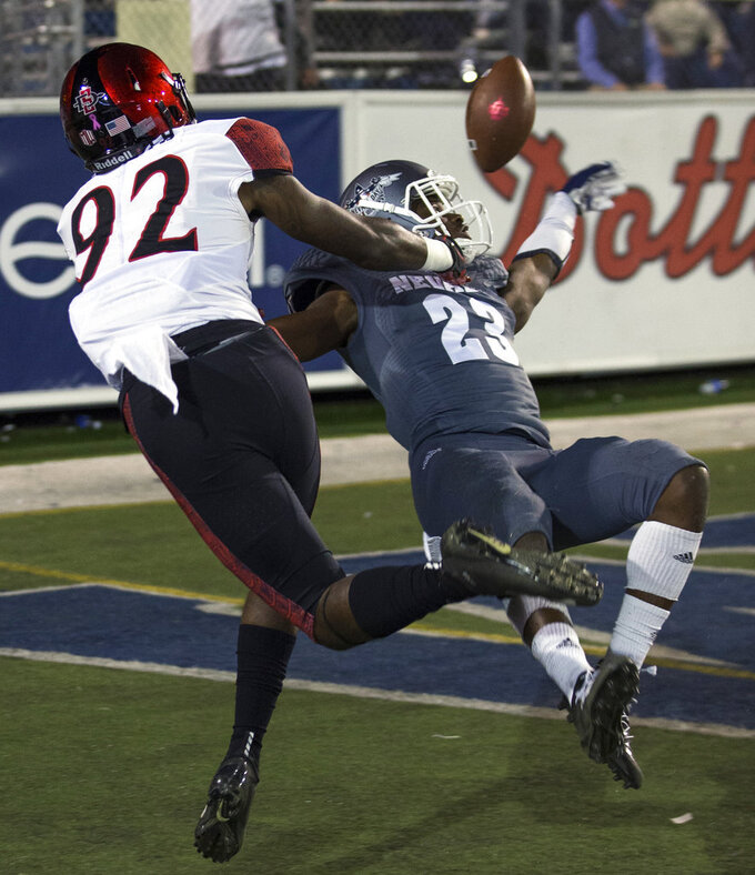 Nevada's Jomon Dotson (23) breaks up a pass to San Diego State's Kobe Smith (92) in the first half of an NCAA college football game in Reno, Nev., Saturday, Oct. 27, 2018. (AP Photo/Tom R. Smedes)