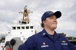 """U.S. Coast Guard Lt. Kelli Normoyle, Commanding Officer of the Coast Guard Cutter Sanibel, stands for a photograph on the deck of the vessel, Thursday, Sept. 16, 2021, at a shipyard, in North Kingstown, R.I. Normoyle was one of two cadets who formally started the process to create the CGA Spectrum Diversity Council just a few months after the law known as """"don't ask, don't tell"""" was repealed on Sept. 20, 2011. (AP Photo/Steven Senne)"""