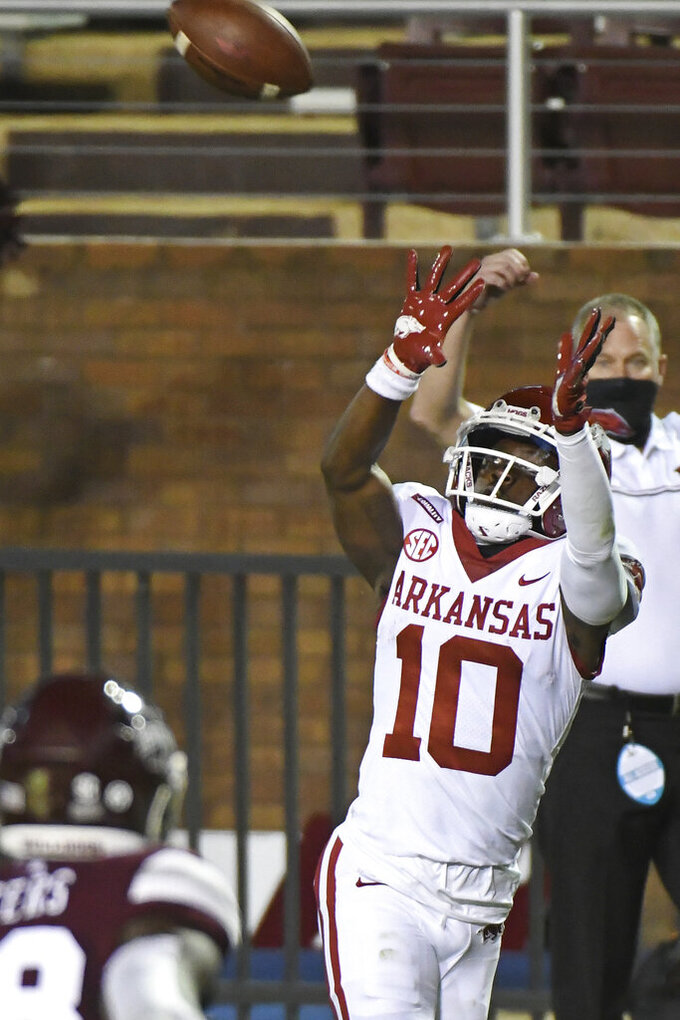 Arkansas wide receiver De'Vion Warren (10) catches a pass for a touchdown during the first half of the team's NCAA college football game against Mississippi State in Starkville, Miss., Saturday, Oct. 3, 2020. (AP Photo/Thomas Graning)