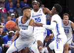 Memphis' forward Precious Achiuwa (55) and guard Damion Baugh (10) move in on New Orleans guard Bryson Robinson (4) in the first half of an NCAA college basketball game Saturday, Dec. 28, 2019, in Memphis, Tenn. (AP Photo/Karen Pulfer Focht)