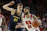 Nebraska's Haanif Cheatham (22) drives around Michigan's Jace Piatkowski (21), during the first half of an NCAA college basketball game in Lincoln, Neb., Tuesday, Jan. 28, 2020. (AP Photo/Nati Harnik)