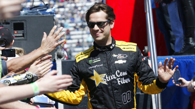 NASCAR Cup Series driver Landon Cassill (0) greets fans during driver introductions prior to the NASCAR Cup Series auto race at the Martinsville Speedway in Martinsville, Va., Sunday, March 24, 2019. (AP Photo/Steve Helber)