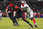 San Diego State safety Trenton Thompson (18) is tackled by New Mexico tight end Kyle Jarvis (5) after Thompson caught an interception during the first half of an NCAA football game Saturday, Oct. 9, 2021, in Carson, Calif. (AP Photo/Ashley Landis)