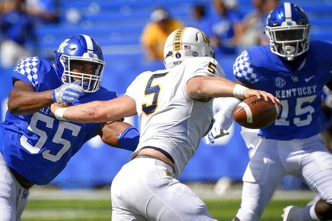 FILE - In this Saturday, Sept. 15, 2018, file photo, Kentucky defensive lineman Davoan Hawkins (55) and linebacker Jordan Wright (15) pressures Murray State quarterback Preston Rice (5) during the second half an NCAA college football game in Lexington, Ky. The Wildcats defense have held up their end by shutting out opponents in the third quarter in particular, but face their biggest challenge against No. 14 Mississippi State and mobile quarterback Nick Fitzgerald on Saturday. (AP Photo/Bryan Woolston, File)