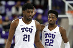 TCU's Kevin Samuel (21) and RJ Nembhard (22) celebrate a basket during the second half of the team's NCAA college basketball game against Louisiana-Lafayette in Fort Worth, Texas, Tuesday, Nov. 12, 2019. (AP Photo/Tony Gutierrez)