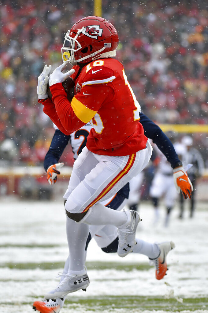 Kansas City Chiefs wide receiver Tyreek Hill (10) makes a touchdown catch in front of Denver Broncos cornerback Chris Harris Jr. during the first half of an NFL football game in Kansas City, Mo., Sunday, Dec. 15, 2019. (AP Photo/Ed Zurga)