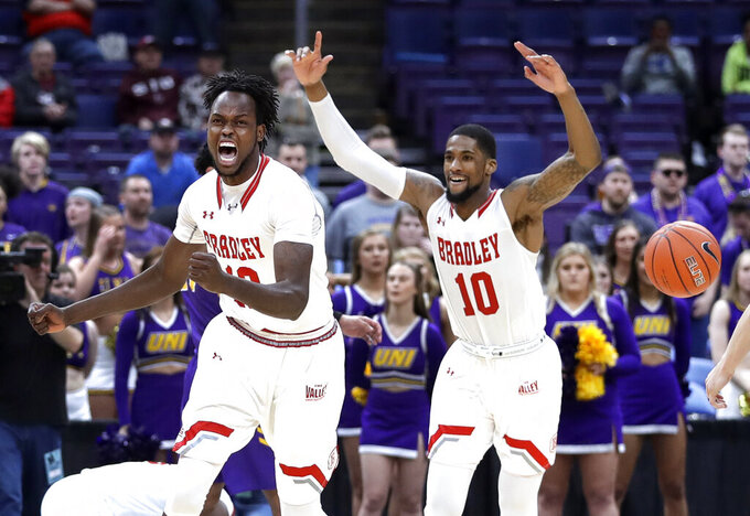 Bradley's Koch Bar and Elijah Childs (10) celebrate as the final horn sounds in an NCAA college basketball game against Northern Iowa during the championship of the Missouri Valley Conference tournament, Sunday, March 10, 2019, in St. Louis. Bradley won 57-54. (AP Photo/Jeff Roberson)