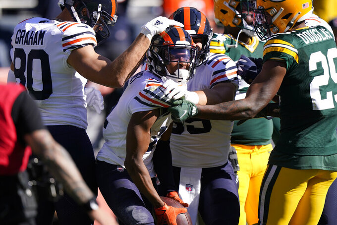 Chicago Bears wide receiver Darnell Mooney, center, is congratulated by tight end Jimmy Graham (80) as Mooney begins to celebrate his touchdown off a pass from Chicago Bears' Justin Fields during the second half of an NFL football game Sunday, Oct. 17, 2021, in Chicago. (AP Photo/Nam Y. Huh)