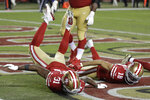 San Francisco 49ers running back Raheem Mostert (31) celebrates after scoring a touchdown with wide receiver Dante Pettis (18) during the second half of an NFL football game against the Green Bay Packers in Santa Clara, Calif., Sunday, Nov. 24, 2019. (AP Photo/Ben Margot)