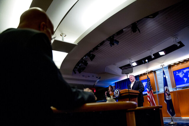 Secretary of State Mike Pompeo speaks during a news conference, Tuesday, March 31, 2020, in Washington. (AP Photo/Andrew Harnik, Pool)