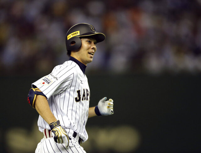 FILE -In this Nov. 21, 2015, file photo, Japan's Shogo Akiyama rounds third base after hitting two-run home run against Mexico in the seventh inning to end their third-place game at the Premier12 world baseball tournament at Tokyo Dome in Tokyo. Akiyama has agreed to a $21 million, three-year deal with the Cincinnati Reds, the only major league team that has not had a player born in Japan. Akiyama, 31, became a free agent after his ninth season with the Seibu Lions in Japan's Pacific League, where he was a five-time All-Star. (AP Photo/Toru Takahashi, File)