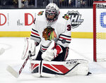 Chicago Blackhawks goalie Jeff Glass defends against the Vegas Golden Knights during the second period of an NHL hockey game Tuesday, Feb. 13, 2018, in Las Vegas. (AP Photo/David Becker)
