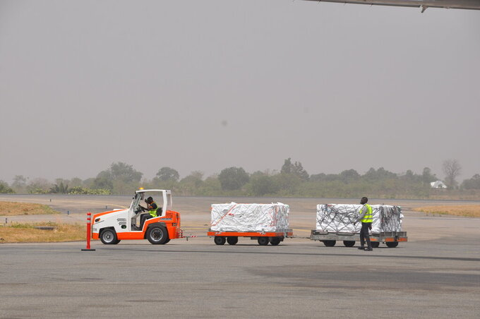COVID-19 vaccines are offloaded from a plane at Lagos airport, Tuesday March 2, 2021. Nigeria received vaccines acquired through the United Nations-backed COVAX initiative with a delivery of the AstraZeneca vaccine made by the Serum Institute of India. (AP Photo/Gbemiga Olamikan)