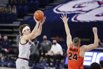 Gonzaga forward Corey Kispert shoots over Pacific guard Broc Finstuen during the first half of an NCAA college basketball game in Spokane, Wash., Saturday, Jan. 23, 2021. (AP Photo/Young Kwak)