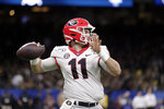 Georgia quarterback Jake Fromm looks for a receiver during the first half of the team's Sugar Bowl NCAA college football game against Baylor in New Orleans, Wednesday, Jan. 1, 2020. (AP Photo/Brett Duke)