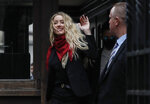 "Actress Amber Heard, center, arrives at the High Court in London, Thursday, July 16, 2020. Actor Johnny Depp is suing News Group Newspapers, publisher of The Sun, and the paper's executive editor, Dan Wootton, over an April 2018 article that called him a ""wife-beater."" The Sun's defense relies on a total of 14 allegations by Heard of Depp's violence. He strongly denies all of them.  (AP Photo/Alastair Grant)"