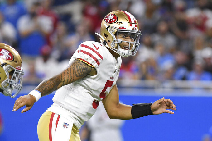 San Francisco 49ers quarterback Trey Lance signals at the line of scrimmage against the Detroit Lions In the first half of an NFL football game in Detroit, Sunday, Sept. 12, 2021. (AP Photo/Lon Horwedel)