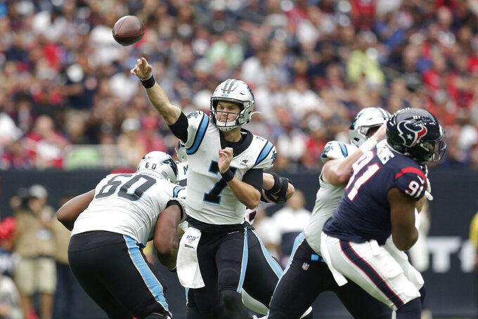 Carolina Panthers quarterback Kyle Allen (7) throws against the Houston Texas during the first half of an NFL football game Sunday, Sept. 29, 2019, in Houston. (AP Photo/Michael Wyke)