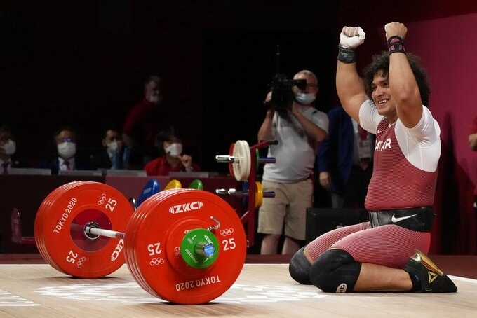 CORRECTS LAST NAME TO ELBAKH FROM ELBACH - Fares Elbakh of Qatar celebrates after winning the gold medal in the men's 81kg weightlifting event, at the 2020 Summer Olympics, Saturday, July 31, 2021, in Tokyo, Japan. (AP Photo/Luca Bruno)