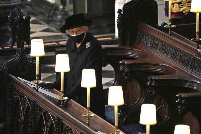 Britain's Queen Elizabeth II in St. George's Chapel during the funeral of Prince Philip, the man who had been by her side for 73 years, at Windsor Castle, Windsor, England, Saturday April 17, 2021. Prince Philip died April 9 at the age of 99 after 73 years of marriage to Britain's Queen Elizabeth II. (Yui Mok/Pool via AP)