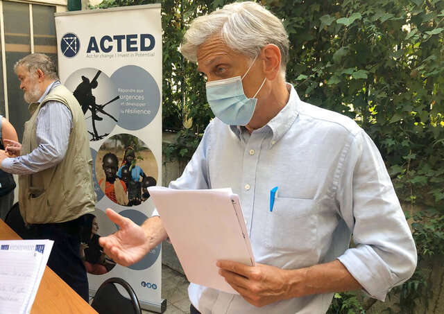 Frederic de Saint-Sernin, vice-CEO of non governmental organization ACTED, answers reporters in Paris, Monday Aug.10, 2020 in Paris. French anti-terrorism prosecutors formally opened an investigation one day after eight people, including six French nationals, were killed by gunmen in a Niger giraffe park. (AP Photo/Nicolas Garriga)