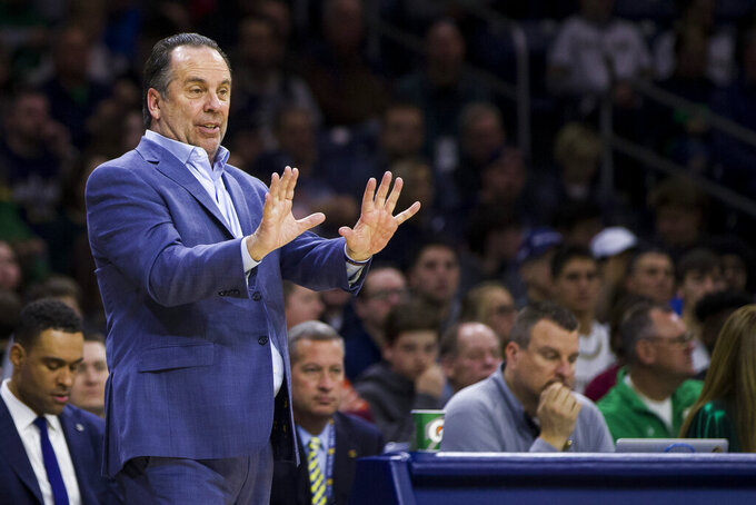 File-This March 7, 2020, file photo shows Notre Dame head coach Mike Brey during an NCAA college basketball game against Virginia Tech in South Bend, Ind. Brey doesn't know what to expect from playing a full season in the midst of the COVID-19 pandemic, but he figures his Notre Dame men's basketball team might as well have fun playing it. (AP Photo/Robert Franklin, File)