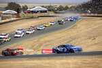 Kyle Larson (5) leads the field during a NASCAR Cup Series race, Sunday, June 6, 2021, at Sonoma Raceway in Sonoma, Calif. (AP Photo/D. Ross Cameron)