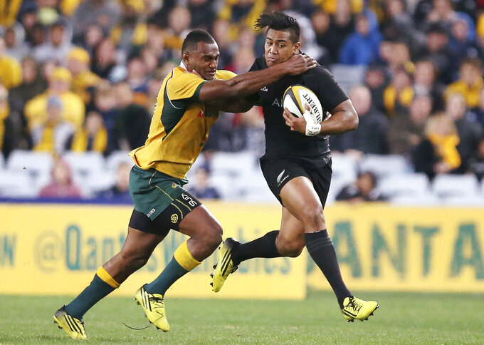 FILE - In this Aug. 8, 2015, file photo, New Zealand's Julian Savea, right, is tacked by Australia's Tevita Kuridrani during their Rugby Championship match in Sydney. Australia is set to host the Rugby Championship in November and December after a late change of mind by governing body SANZAAR, Friday, Sept. 11, 2020. (AP Photo/Rick Rycroft, File)