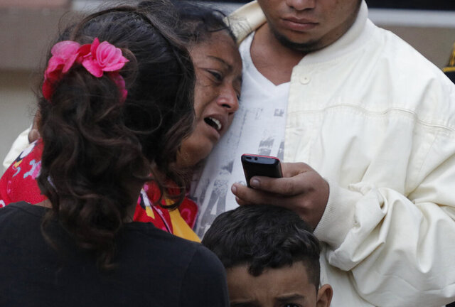 A woman cries outside the morgue after learning her husband, Dionisio Heriberto Solis, is one of the prisoners who died in a riot inside El Porvenir prison, in Tegucigalpa, Honduras, Monday, Dec. 23, 2019. At least 16 prisoners died during fighting inside a detention center in Honduras on Sunday, two days after rioting at another prison killed 18 inmates, authorities said. (AP Photo/Elmer Martinez)