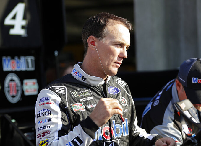 Kevin Harvick prepares to climb into his car before practice for Sunday's NASCAR Cup Series auto race at Charlotte Motor Speedway in Concord, N.C., Saturday, May 25, 2019. (AP Photo/Chuck Burton)