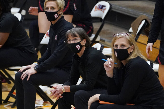 Stanford head coach Tara VanDerveer, center, watches the action against Pacific during the first half of an NCAA college basketball game in Stockton, Calif., Tuesday, Dec. 15, 2020. With a win over Pacific, VanDerveer will become the winningest women's coach in history breaking Pat Summitt's record of 1,098. (AP Photo/Rich Pedroncelli)