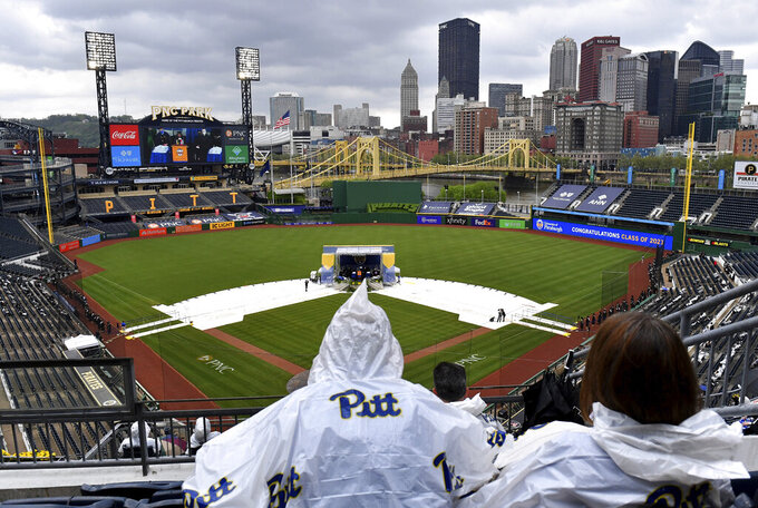 Family and friends watch as students receive their diplomas duirng the University of Pittsburgh's commencement exercise, Tuesday, May 4, 2021, at PNC Park in Pittsburgh. (Matt Freed/Pittsburgh Post-Gazette via AP)