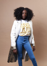 In this Dec. 19, 2018 photo, social media personality Kheris Rogers poses for a portrait in Los Angeles.  Rogers launched her own fashion line with T-shirts sporting,