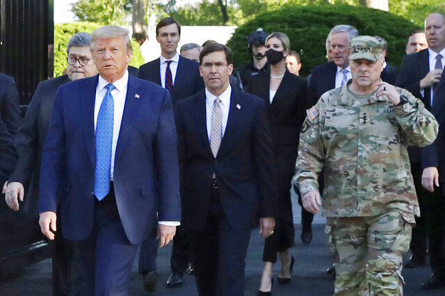 "FILE - In this June 1, 2020 file photo, President Donald Trump departs the White House to visit outside St. John's Church, in Washington. Walking behind Trump from left are, Attorney General William Barr, Secretary of Defense Mark Esper and Gen. Mark Milley, chairman of the Joint Chiefs of Staff. Milley crafted a low public profile in his first eight months on the job, but that changed after ""the walk."" Milley walked with President Donald Trump and a presidential entourage across Lafayette Square on June 1 to be positioned near a church where Trump held up a Bible for photographers.(AP Photo/Patrick Semansky, File)"
