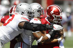 Indiana quarterback Peyton Ramsey (12) is sacked by Ohio State defensive end Chase Young (2) and defensive tackle Davon Hamilton (53) during the first half of an NCAA college football game, Saturday, Sept. 14, 2019, in Bloomington, Ind. (AP Photo/Darron Cummings)
