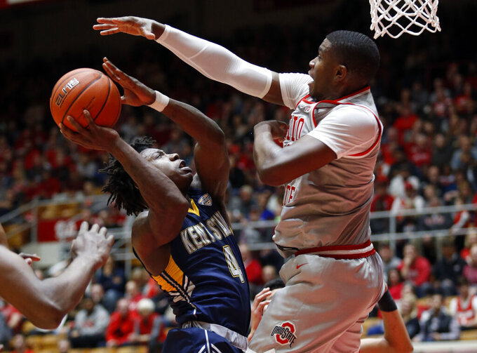 Kent State guard Antonio Williams, left, goes up to shoot in front of Ohio State forward E.J. Liddell during the first half of an NCAA college basketball game in Columbus, Ohio, Monday, Nov. 25, 2019. (AP Photo/Paul Vernon)