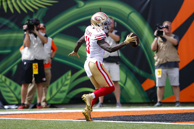 San Francisco 49ers wide receiver Marquise Goodwin (11) runs in a touchdown during the first half an NFL football game against the Cincinnati Bengals, Sunday, Sept. 15, 2019, in Cincinnati. (AP Photo/Gary Landers)