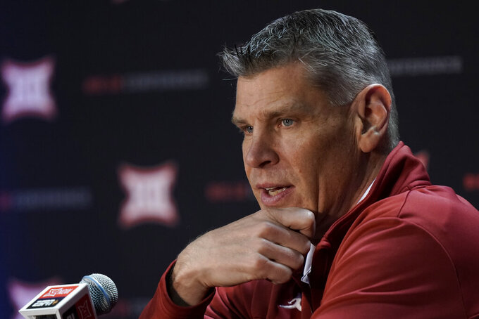 Oklahoma coach Porter Moser speaks to the media during Big 12 NCAA college basketball media day Wednesday, Oct. 20, 2021, in Kansas City, Mo. (AP Photo/Charlie Riedel)