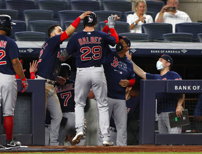Boston Red Sox's Bobby Dalbec (29) celebrates at the dugout with teammates after hitting a home run against the New York Yankees during the eighth inning of a baseball game Saturday, June 5, 2021, in New York. (AP Photo/Noah K. Murray)