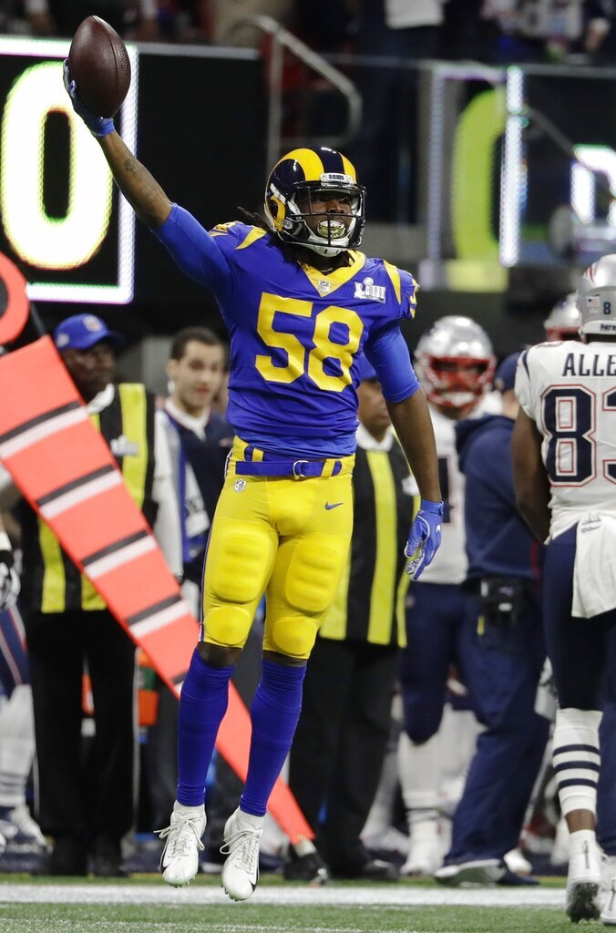 Los Angeles Rams' Cory Littleton celebrates after his interception against the New England Patriots during the first half of the NFL Super Bowl 53 football game Sunday, Feb. 3, 2019, in Atlanta. (AP Photo/Chuck Burton)