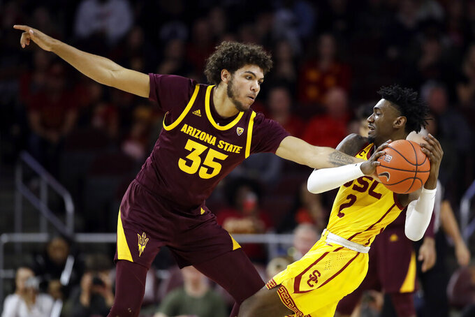 Arizona State forward Taeshon Cherry (35) defends on Southern California guard Jonah Mathews (2) during the second half of an NCAA college basketball game Saturday, Feb. 29, 2020, in Los Angeles. (AP Photo/Marcio Jose Sanchez)