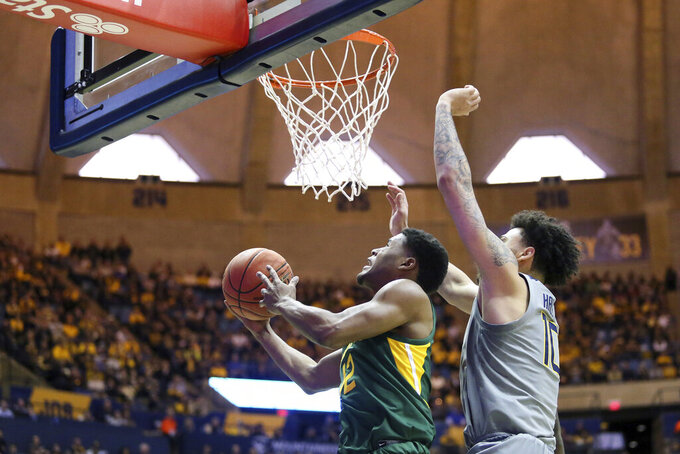 Baylor guard Jared Butler (12) shoots past West Virginia guard Jermaine Haley (10) during the first half of an NCAA college basketball game Saturday, March 7, 2020, in Morgantown, W.Va. (AP Photo/Kathleen Batten)