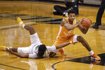 Tennessee's Josiah-Jordan James, right, and Missouri's Dru Smith, left, scramble for a loose ball during the first half of an NCAA college basketball game Wednesday, Dec. 30, 2020, in Columbia, Mo. (AP Photo/L.G. Patterson)