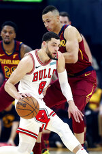 Chicago Bulls' Zach LaVine (8) drives against Cleveland Cavaliers' Dante Exum, right, in the first half of an NBA basketball game, Saturday, Jan. 25, 2020, in Cleveland. (AP Photo/Ron Schwane)